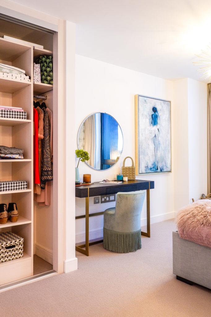 modern London apartment with dressing area and pink and blue design scheme