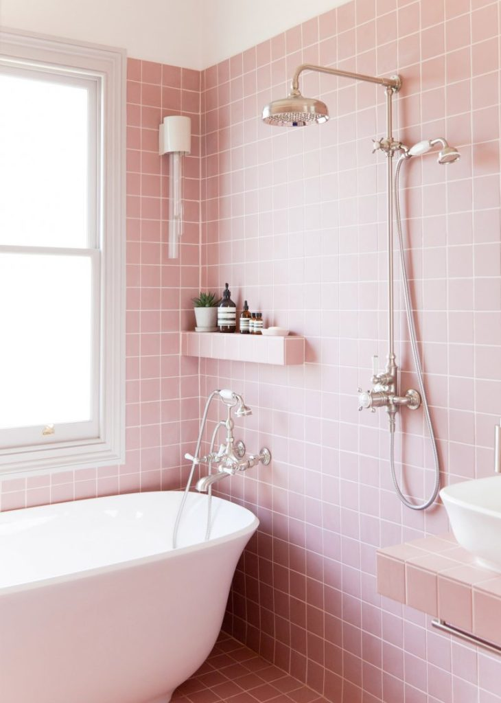 fully pink tiled bathroom with silver hardware