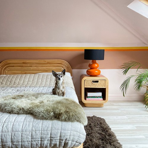 70s style rental-friendly pink bedroom with mural