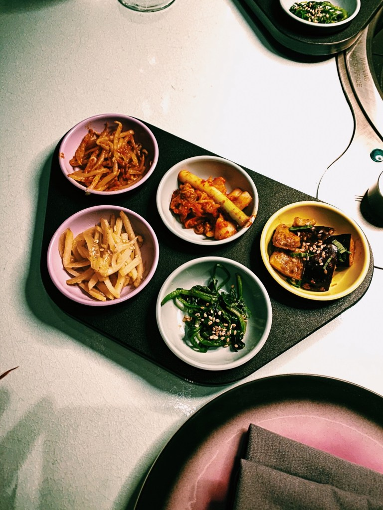 korean bbq sharing platter in pastel dishes