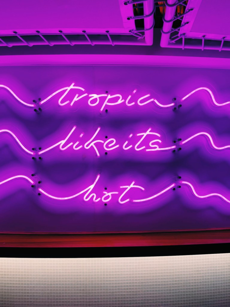 tropic like its hot neon sign