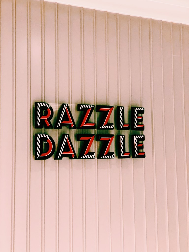 multi-coloured sign depicting dazzle dazzle