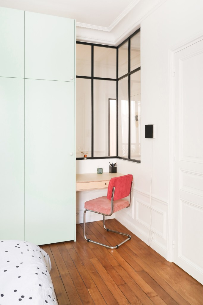 minimal bedroom office with pink cantilever chair