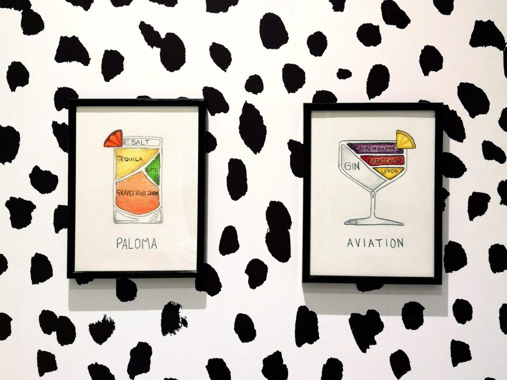 two cocktail prints on Dalmatian print wall