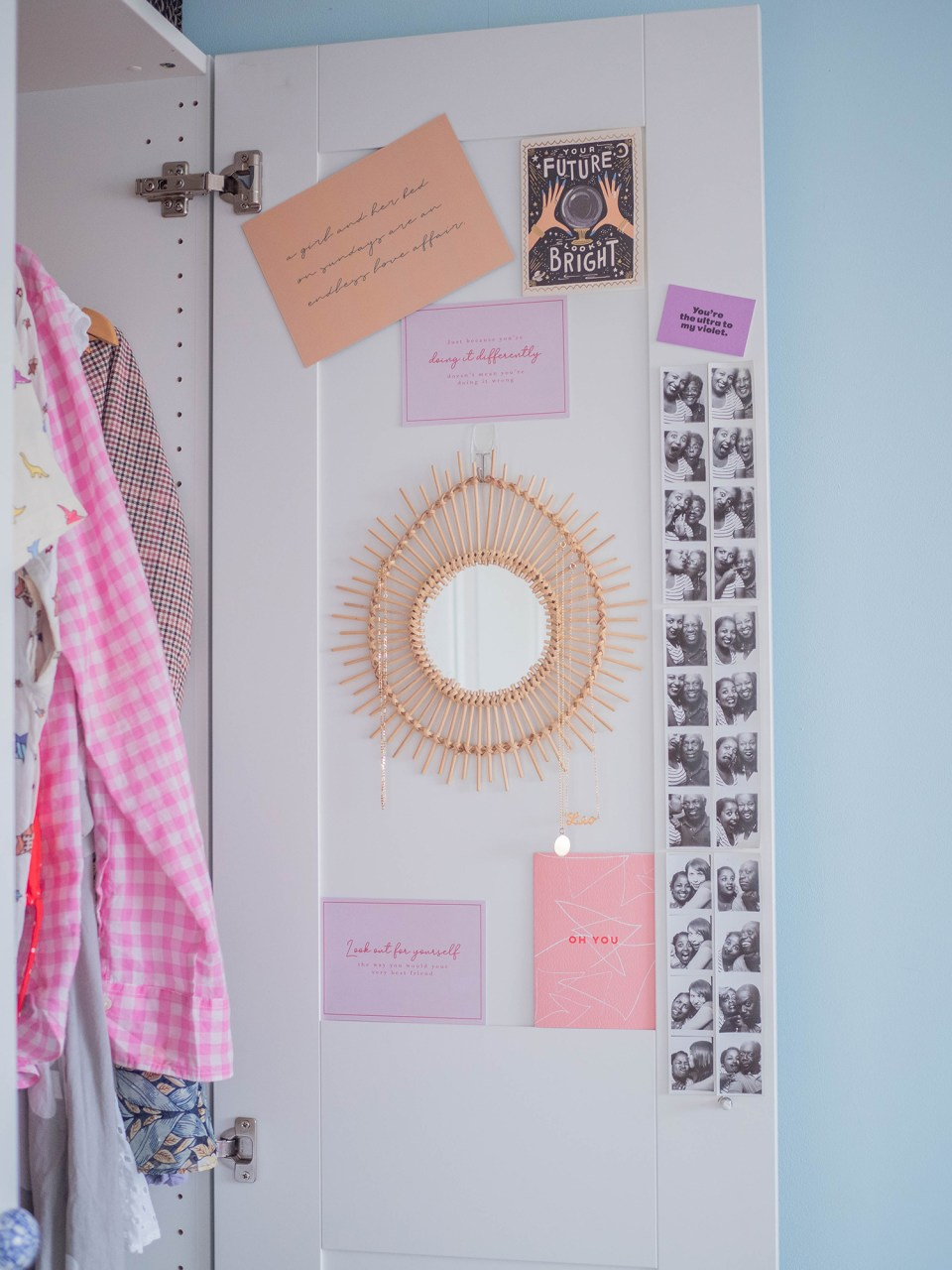 interior of cupboard with mirror and photographs