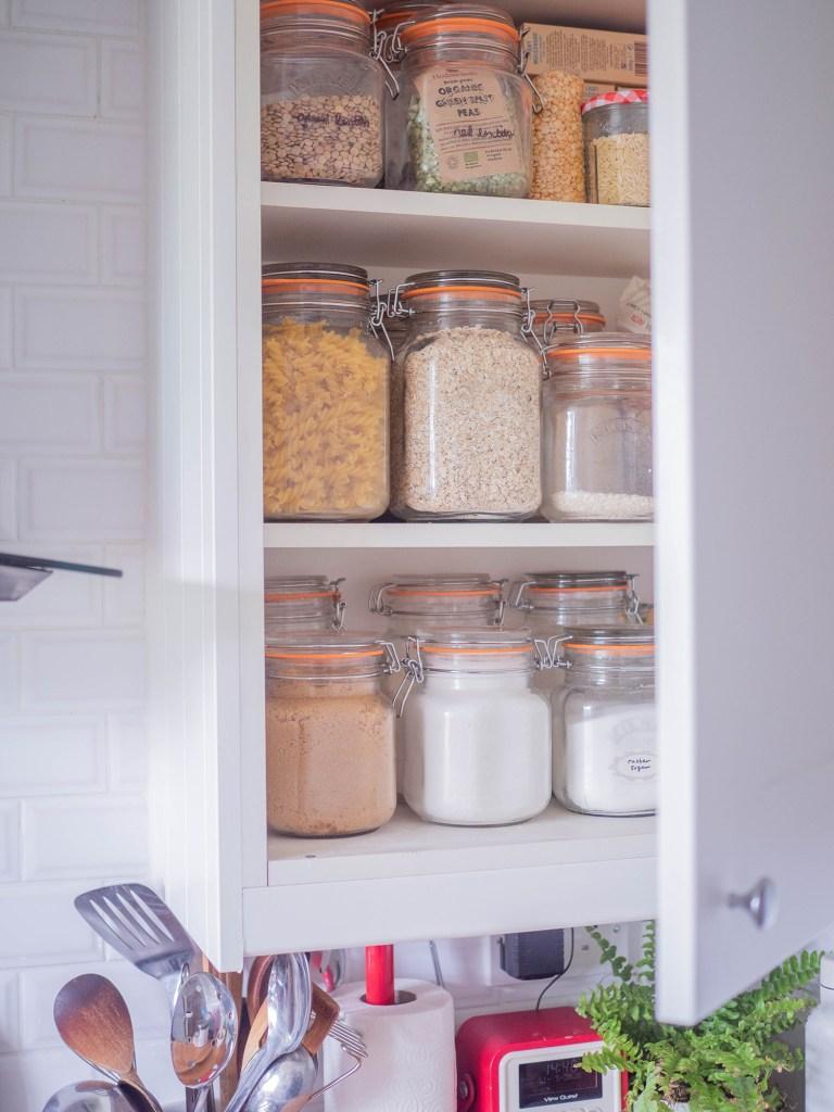 organised cupboard with kilner jars