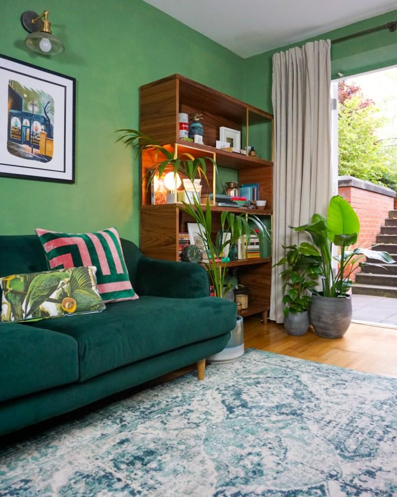 green living room with velvet green sofa
