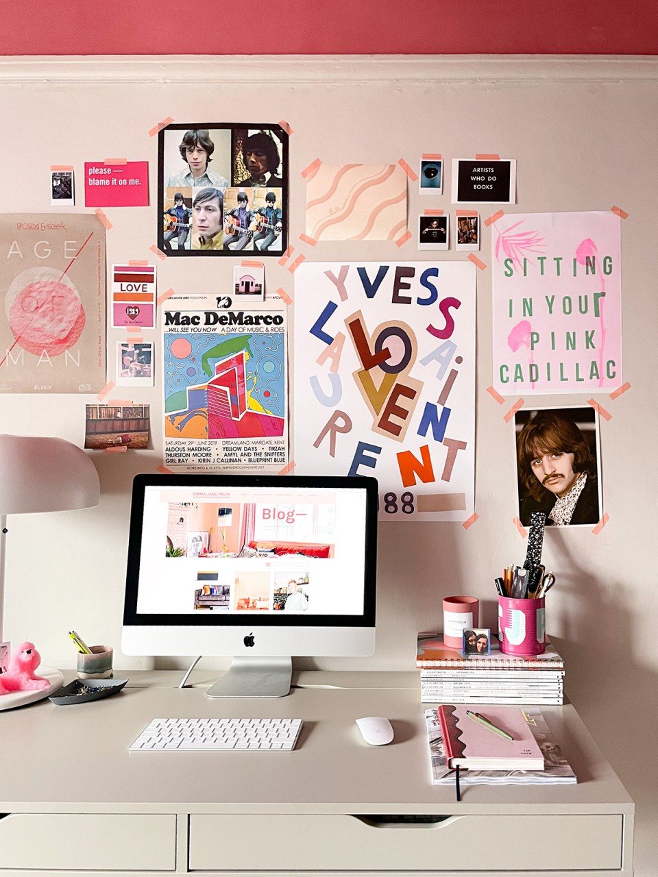 multifunctional home office space with artwork on walls