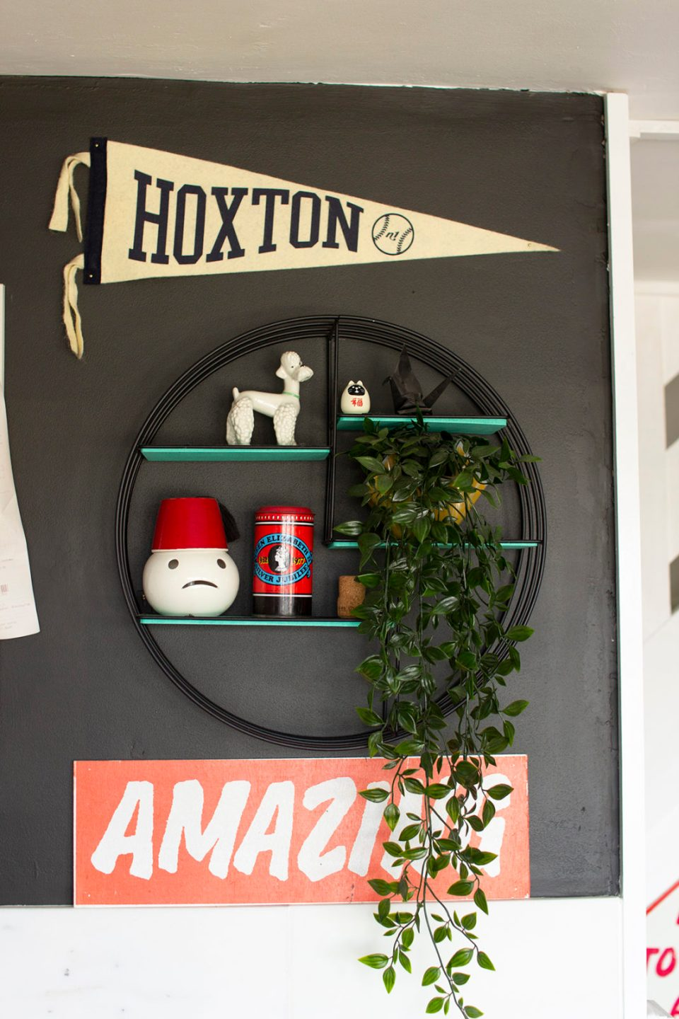 kitchen artwork with hoxton flag and amazing sign