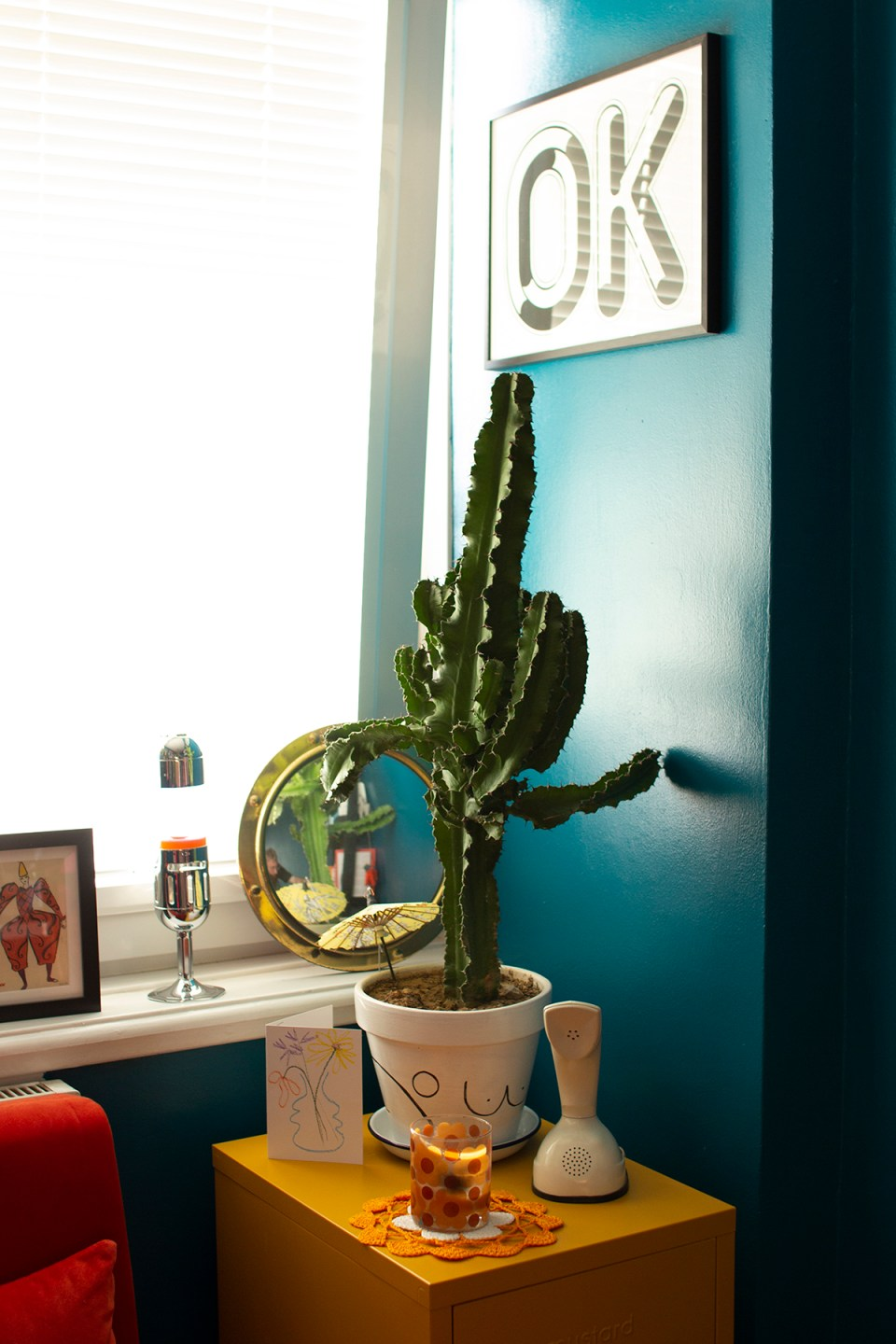 bright teal office meets guest bedroom with cacti