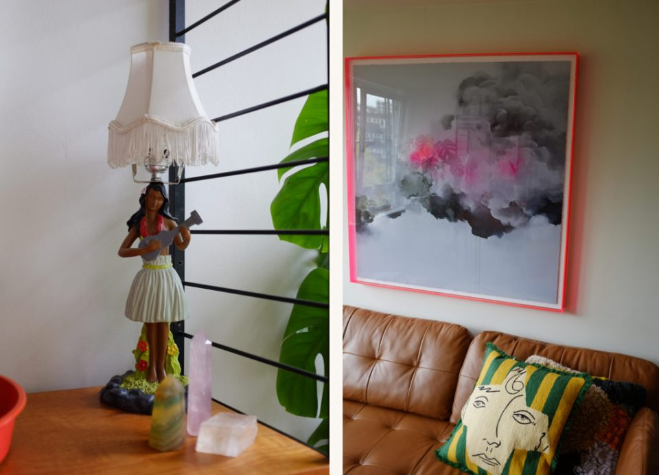 neutral living room with hula girl lamp and neon pink art frame