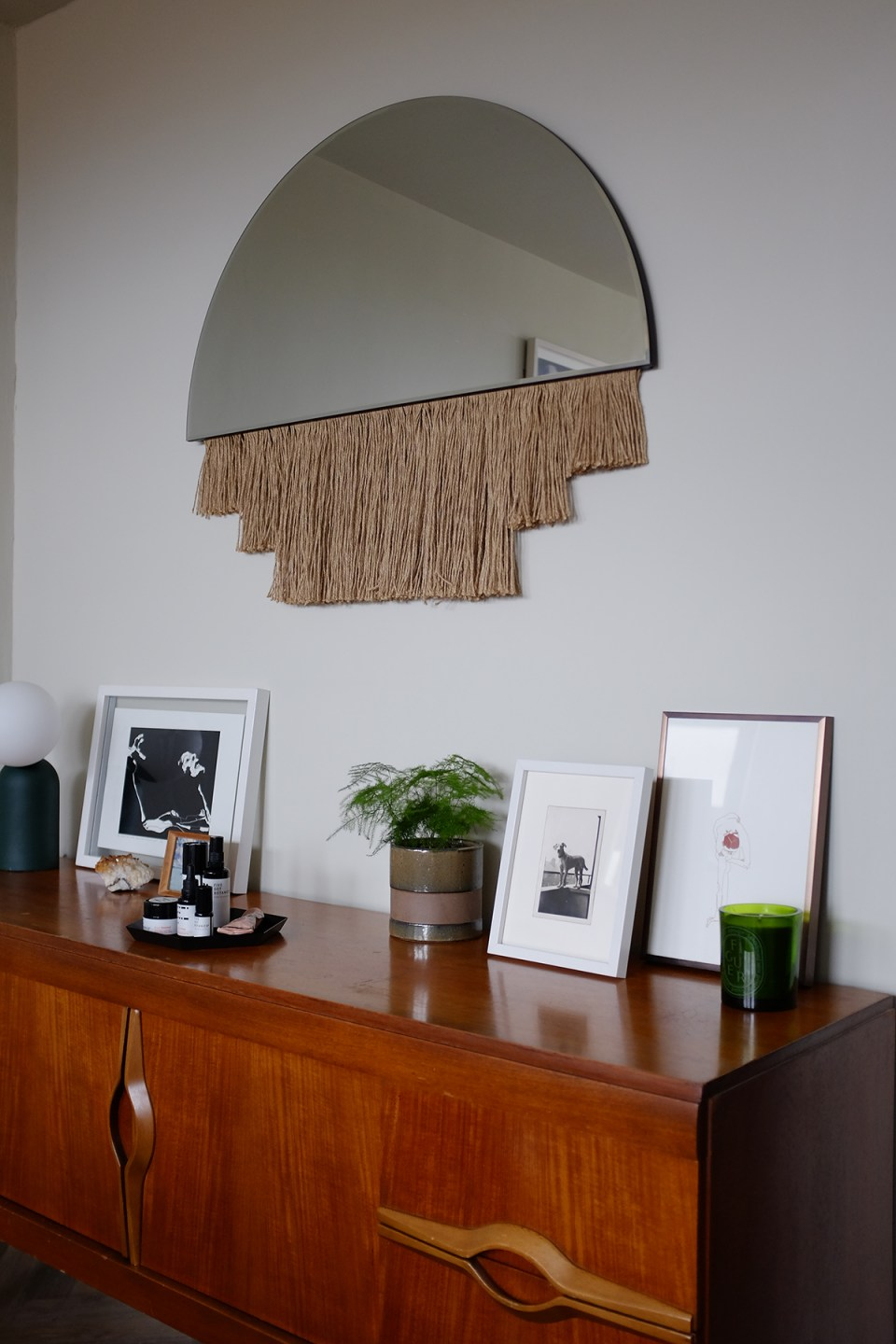 mid-century sideboard with fringed mirror