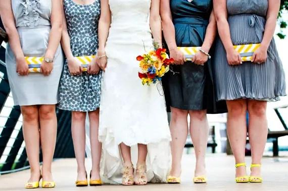 bridesmaids holding clutch purses
