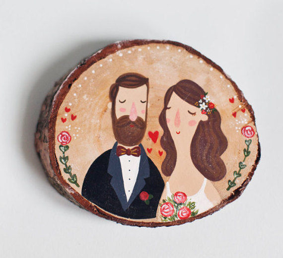 Painted wood slice decoration for whimsical weddings by The Roomba | via Wood Themed Wedding Ideas: http://emmalinebride.com/themes/wood-themed-wedding-ideas/