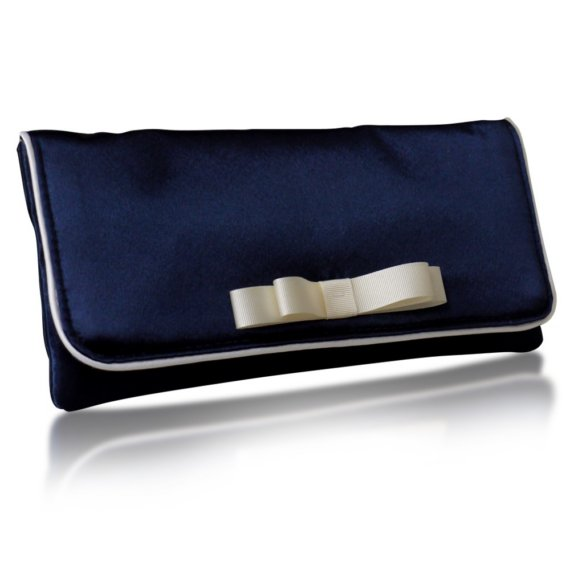 navy blue clutch with bow | via 50+ nautical wedding theme ideas at EmmalineBride.com