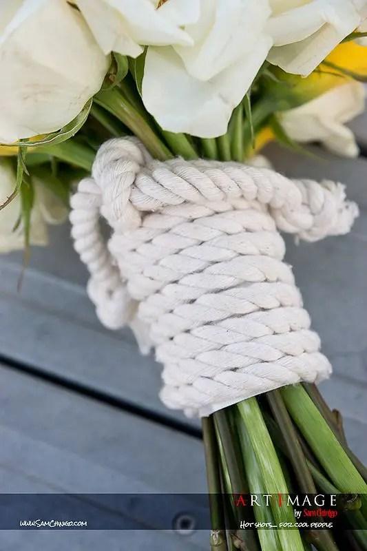 bouquet wrapped in rope   photo: sam chinigo   wedding bouquet wraps: http://emmalinebride.com/bouquets/wedding-bouquet-wraps/