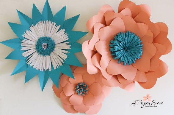 paper flower backdrop in peach and aqua