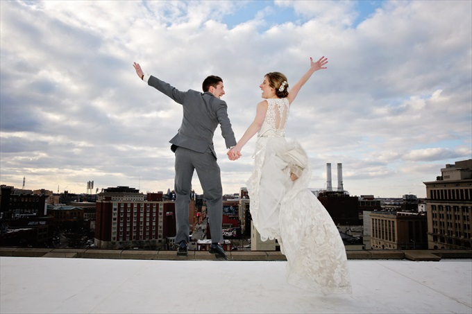 detroit_wedding_bride_groom_jump_roof Downtown Detroit Wedding - http://emmalinebride.com/real-weddings/a-beautiful-downtown-detroit-wedding-nick-jeannine/ | Michigan wedding photographer - The Camera Chick