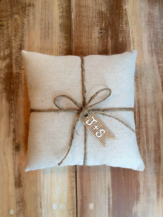 natural cotton ring bearer pillow with burlap tag initials | 41 Beautiful Rustic Ring Pillows on Etsy | http://emmalinebride.com/rustic/ring-pillows-etsy-weddings/