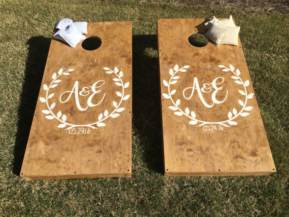 custom wedding cornhole boards by StarsStripesSawdust via 26 Things Guests Love at Weddings from A to Z | http://emmalinebride.com/planning/things-guests-love-at-weddings/