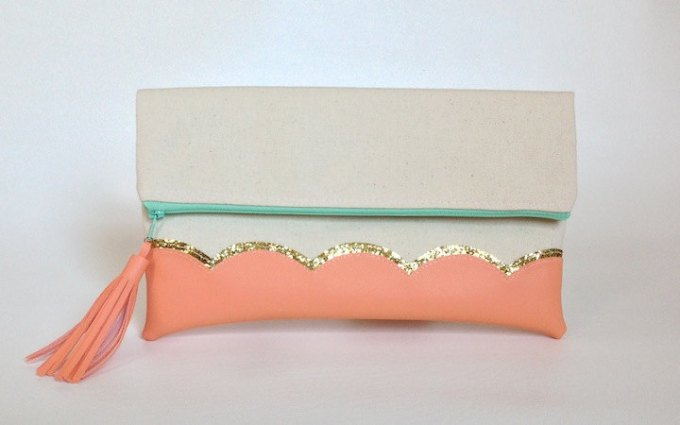 Peach clutch purse with tassel by This Loves That via 21 Festive Tassel Wedding Decorations & Accessories | http://emmalinebride.com/themes/tassel-wedding-decorations/