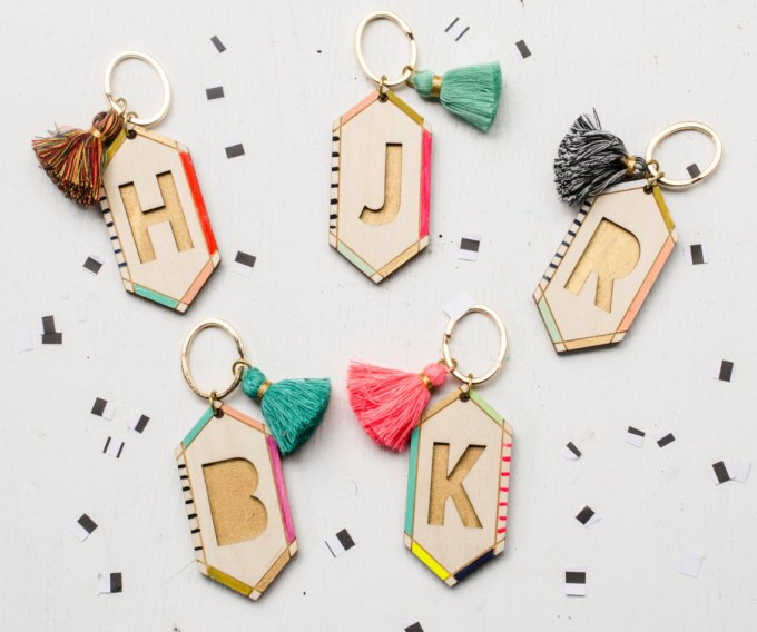 Tassel initial keychains by JillMakes via 21 Festive Tassel Wedding Decorations & Accessories | http://emmalinebride.com/themes/tassel-wedding-decorations/