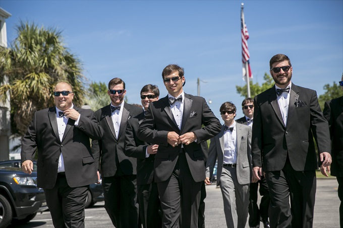 groom and groomsmen walking in this Crystal Coast Wedding | North Carolina wedding photographed by Ellen LeRoy Photography - http://emmalinebride.com/real-weddings/breathtaking-crystal-coast-wedding-mara-will-married/