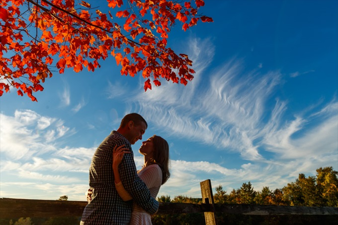 couple kisses under blue skies during fall engagement session| engagement photography by Butler Photography LLC.| Love Fall Weddings? See this Somers, CT Engagement Session - http://emmalinebride.com/real-weddings/love-the-fall-weddings-see-this-somers-ct-engagement-session/