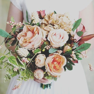 This blush bouquet is actually faux it is made withhellip