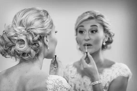 Wedding of Caitlin & Ben at The Villa - bride applying makeup