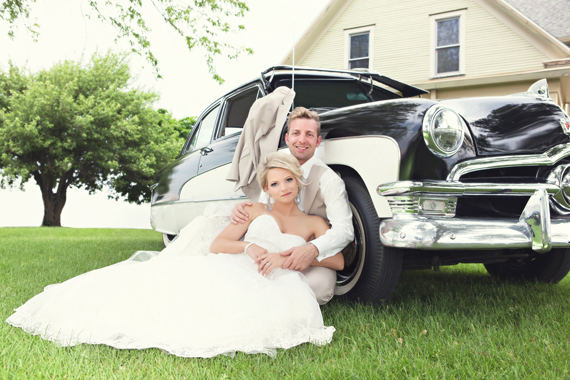 KimAnne Photography - iowa backyard wedding - bride-groom-pose-classic-car