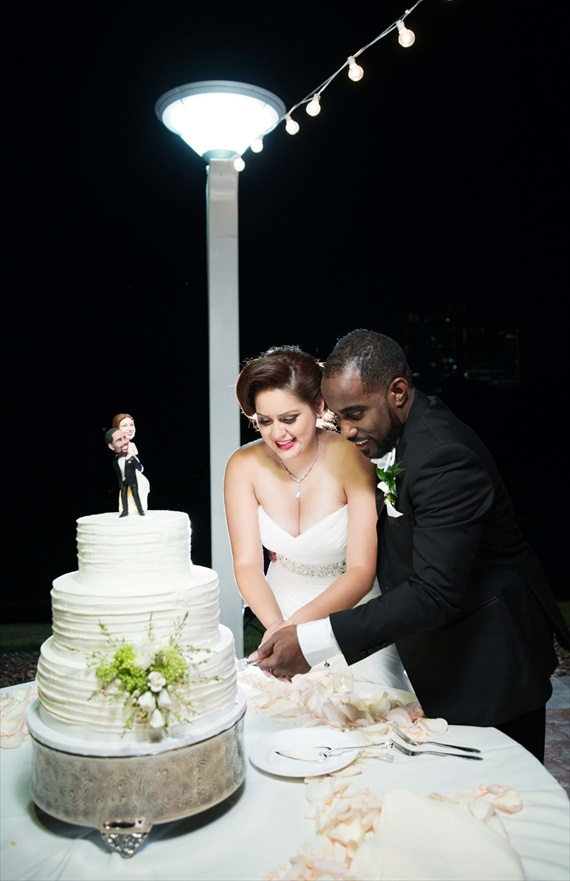 Imagine Studios - couple cuts the cake at las vegas wedding