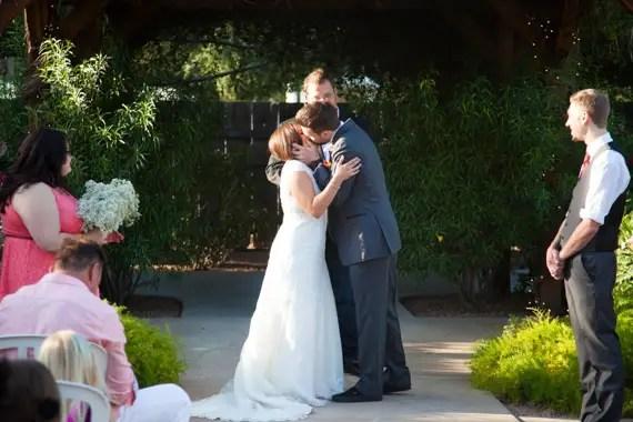 bride and groom kiss at Gilbert, Arizona wedding