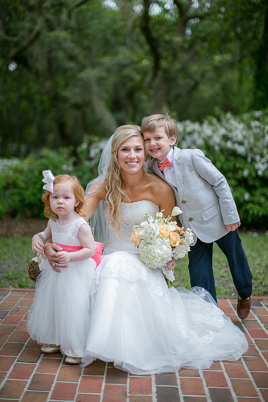 The Bride with Flower Girl and Ring Bearer - Bald Head Island Wedding - Photo by Eric Boneske