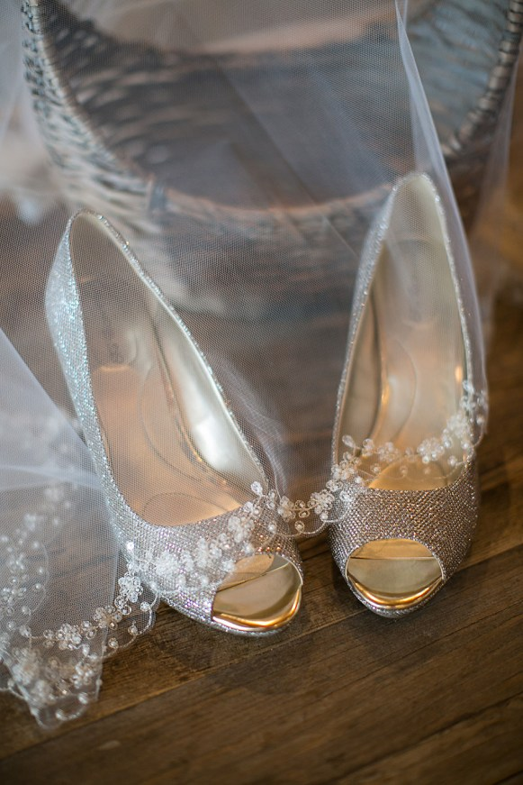The Bride's Veil and Shoes - Bald Head Island Wedding - Photo by Eric Boneske