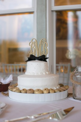 Wedding Cake with Monogram Topper and Black Bow at the Top - Bald Head Island Wedding - Photo by Eric Boneske