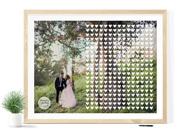 Wedding Guest Book Alternative Print with Hearts Atop Engagement Photo | 21 Unique Themed Guest Book Alternatives via http://emmalinebride.com/reception/themed-guest-book-alternatives/