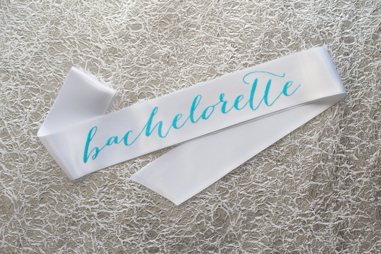 bachelorette sash with aqua writing | stylish bachelorette sash ideas | via http://emmalinebride.com/bride/bachelorette-sash-ideas/