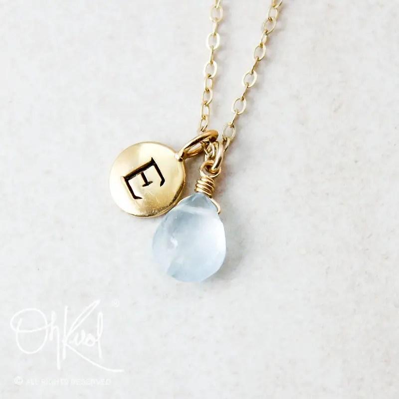 Aquamarine initial necklace, perfect for gifting to bridesmaids! | via Best Aquamarine Jewelry http://emmalinebriide.com/bride/best-aquamarine-jewelry/