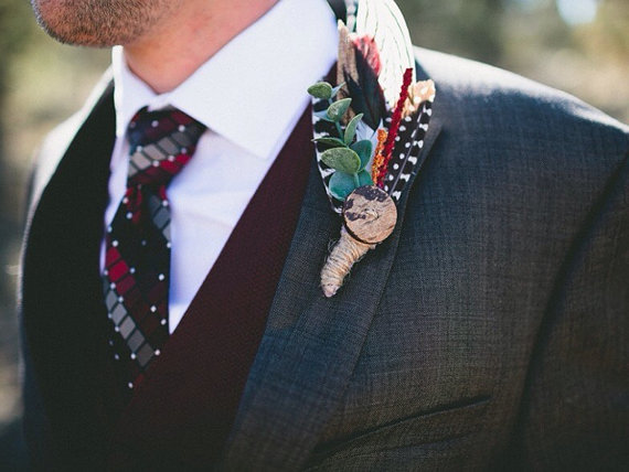 feather boutonniere for bohemian wedding | via What Kind of Boutonniere to Pick (and Why) http://emmalinebride.com/groom/what-kind-of-boutonniere/