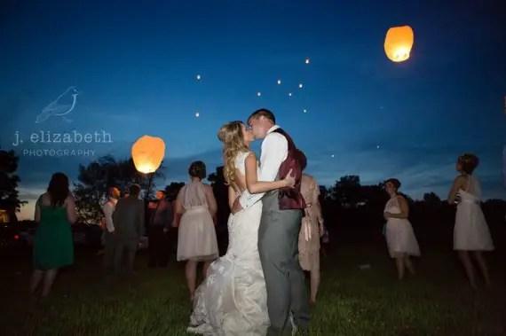 bride, groom, and wedding lanterns for a night wedding