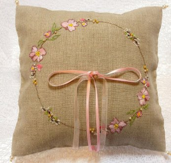 burlap ring pillow with embroidery and pink bow | via Rustic Ring Pillows http://emmalinebride.com/ceremony/rustic-ring-pillows/