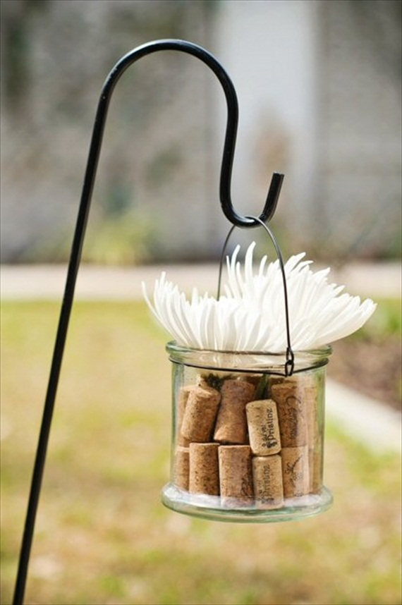 corks in hanging glass from shepherd's hook for ceremony decor - wine themed wedding ideas