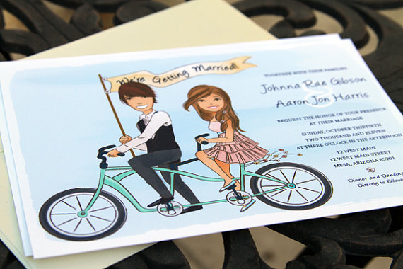 couple riding tandem bicycle smiling save the date // illustrated save the dates