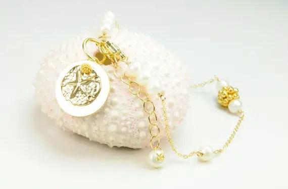 dainty sand dollar bracelet via Beach Wedding Jewelry Ideas for Bridesmaids