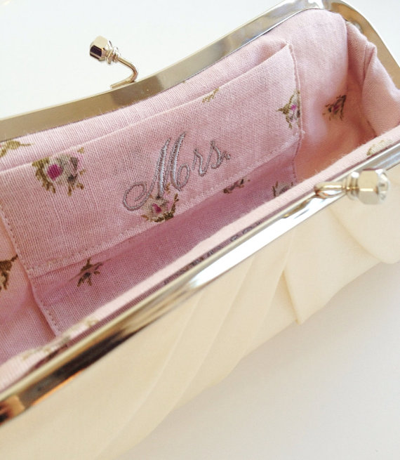 embroidered mrs label inside clutch purse