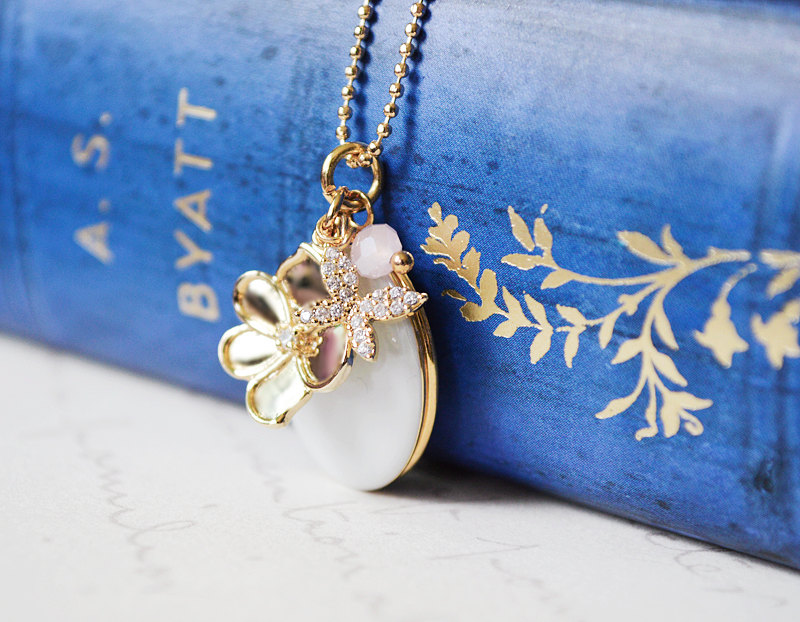 enameled gold locket with flowers via Easy Bridesmaid Gift They'll Really Love via http://emmalinebride.com/gifts/easy-bridesmaid-gift/