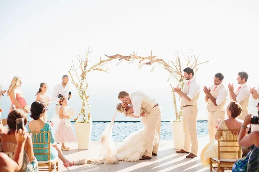 get married under a driftwood arch | photo: sara & rocky | via emmalinebride.com