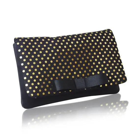 gold and black polka dot clutch bag
