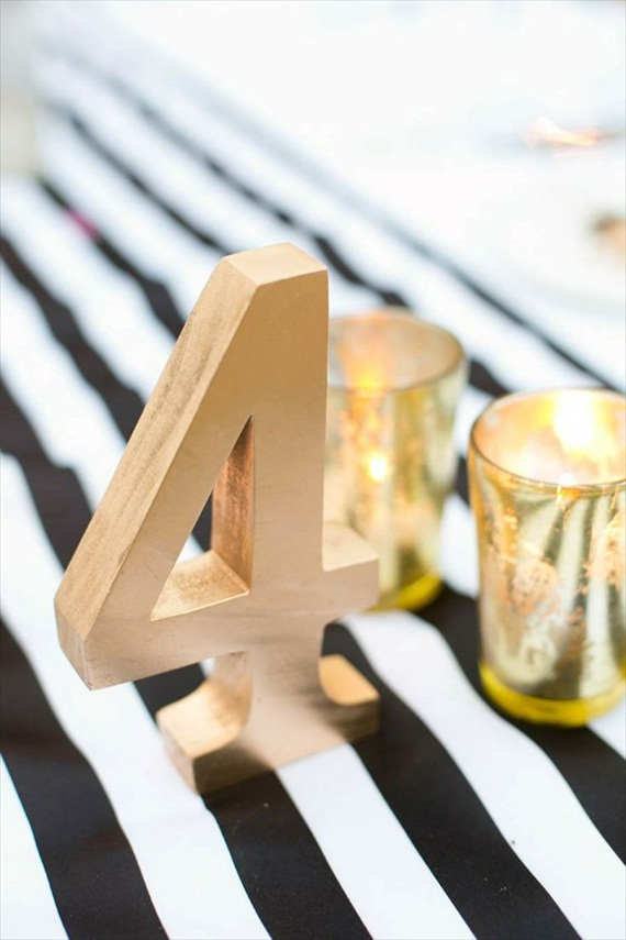 I love the way this gold number pops against the black and white table runner.  You can make your own gold table number with a paper mache numeral or wooden number and gold paint.